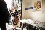 A table full of Ukrainian newspapers for sale in the vestibule of the Greco-Catholic church (precise translation of name TK) serving the Ukrainian community in Warsaw. Here the community gathers after Sunday mass.
