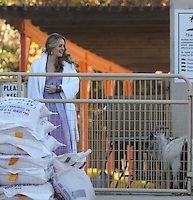 """January 26th, 2011  Acton, CA. ***EXCLUSIVE*** A very pregnant Alicia Silverstone does a Vogue Magazine photo shoot at """"Animal Acres"""" animal sanctuary outside of LA. for which she has been a big supporter of. Alicia spent the day at the shoot laying on a pig, hanging out with some cows, and sitting in a barn with a bunch of turkeys, chickens and ducks. Alicia's Motor Home for the shoot was run on bio diesel fuel. Silverstone was seen snacking on grapes and other healthy items through out the shoot. When the shoot was over, Alicia left for home in her comfortable looking street clothes and flashed a smile as well as a closer look at her baby bump. Photo by Eric Ford 1/818-613-3955  info@onlocationnews.com"""