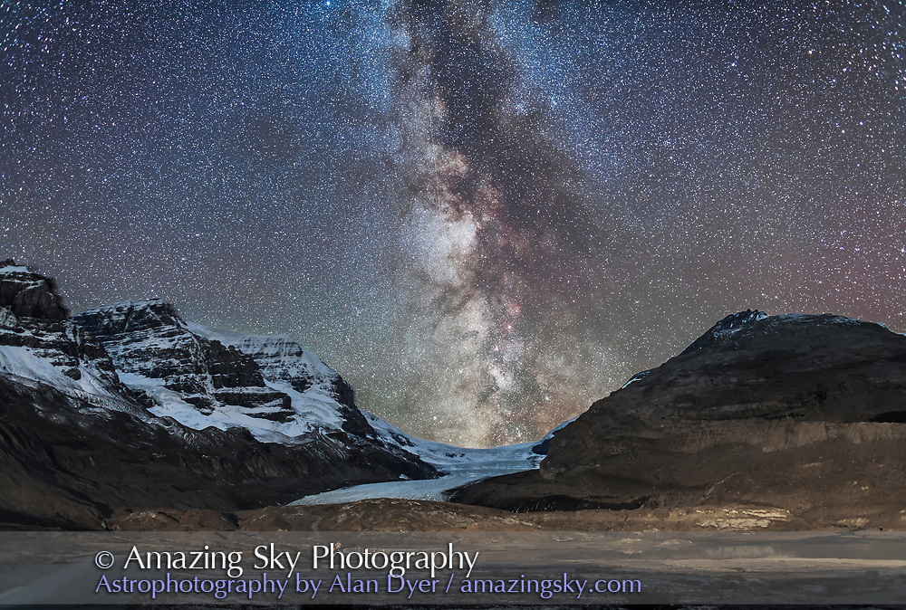 The Milky Way over Athabasca Glacier at the Columbia Icefields in Jasper National Park, Sept 14, 2014 on a very clear night before moonrise. The centre of the Galaxy area in Sagittarius is setting in the southwest behind the Icefields. The foreground light on the moraines is wash from lights on the Glacier View Inn and Icefields Centre. Other ground illumination on the peaks is from starlight. Mt. Andromeda is at left. <br />