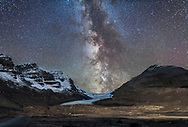 The Milky Way over Athabasca Glacier at the Columbia Icefields in Jasper National Park, Sept 14, 2014 on a very clear night before moonrise. The centre of the Galaxy area in Sagittarius is setting in the southwest behind the Icefields. The foreground light on the moraines is wash from lights on the Glacier View Inn and Icefields Centre. Other ground illumination on the peaks is from starlight. Mt. Andromeda is at left. <br /> <br /> This is a composite of 4 shots, tracked, for the sky, blended in Lighten mode and 4 shots, untracked, for the ground, blended in Mean combine mode to reduce noise. The trailed sky is masked out of the ground shots and the trailed ground is masked out of the sky shots, so both ground and sky are sharp but the sky has the benefit of the longer exposures required to really bring out Milky Way details. Each sky shot was 3 minutes and each ground shot was 4 minutes, all at f/2.5 with the 24mm lens and Canon 6D at ISO 1250. Tracked on the Sky-Watcher Star Adventurer, with the drive turned off for the ground images at the end of the sky exposures.