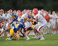 Oxford High's K.T. McCollin (4) vs. Jackson Prep's Ian McGraw (24) in Oxford, Miss. on Friday, August 23, 2013. Oxford won 32-20.