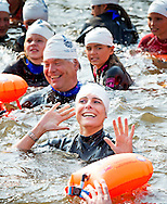 4-9-2014 AMSTERDAM-  Princess Laurentien of the Netherlands swims in the canals of Amsterdam with children to promote saving water for the foundation Missing Chapter  , September 4th. COPYRIGHT ROBIN UTRECHT