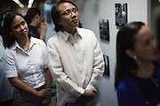 Commissioner for climate change Nadarev Yeb Saño opened a photographic exhibition with Senator Loren Legarda and Senator Grace Po. The exhibition was on climate change and was held in the Senate of the Philippines in Manila.