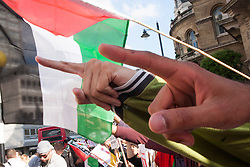 London, July 15th 2014. Angry fingers point at the BBC as Palestinians and their supporters demonstrate outside the BBC's headquarters against an alleged pro-Israeli bias in their coverage of Palestinian affairs.