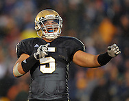 Te'o celebrates during the the overtime win over Washington in 2009, not to be his last overtime in the rain.