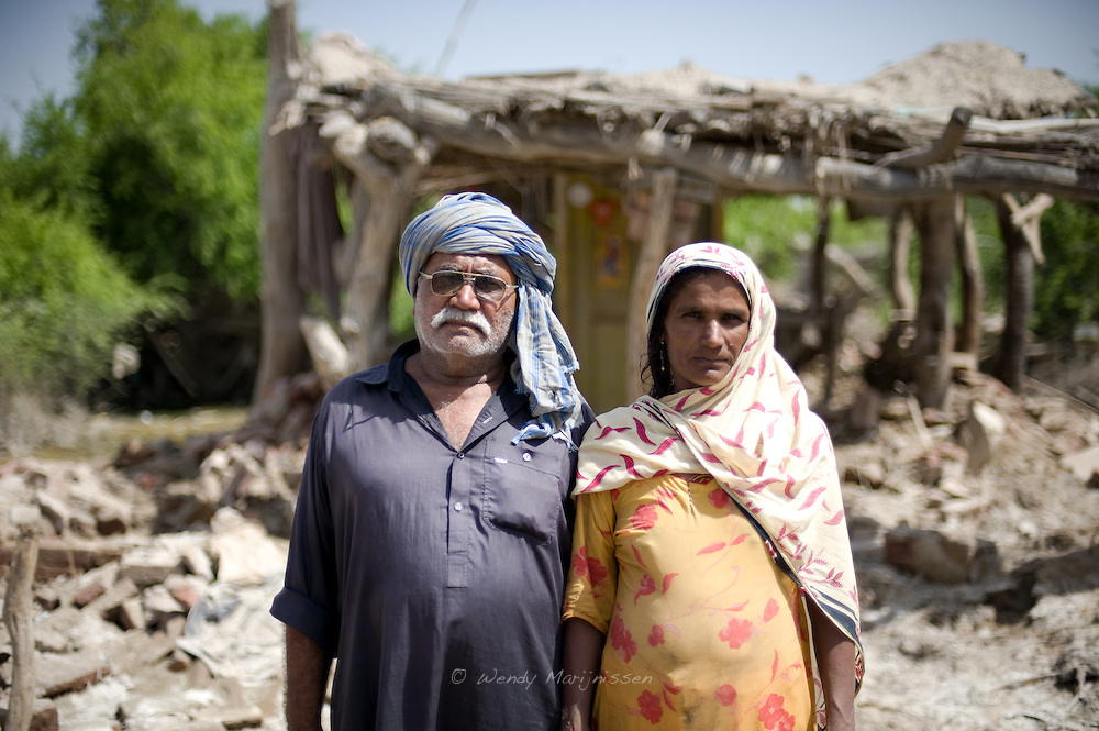 A couple stands in front of their home now completely destroyed by the devastating floods that caused havoc in the whole of Paksitan. Jamshoro, Pakistan, 2010