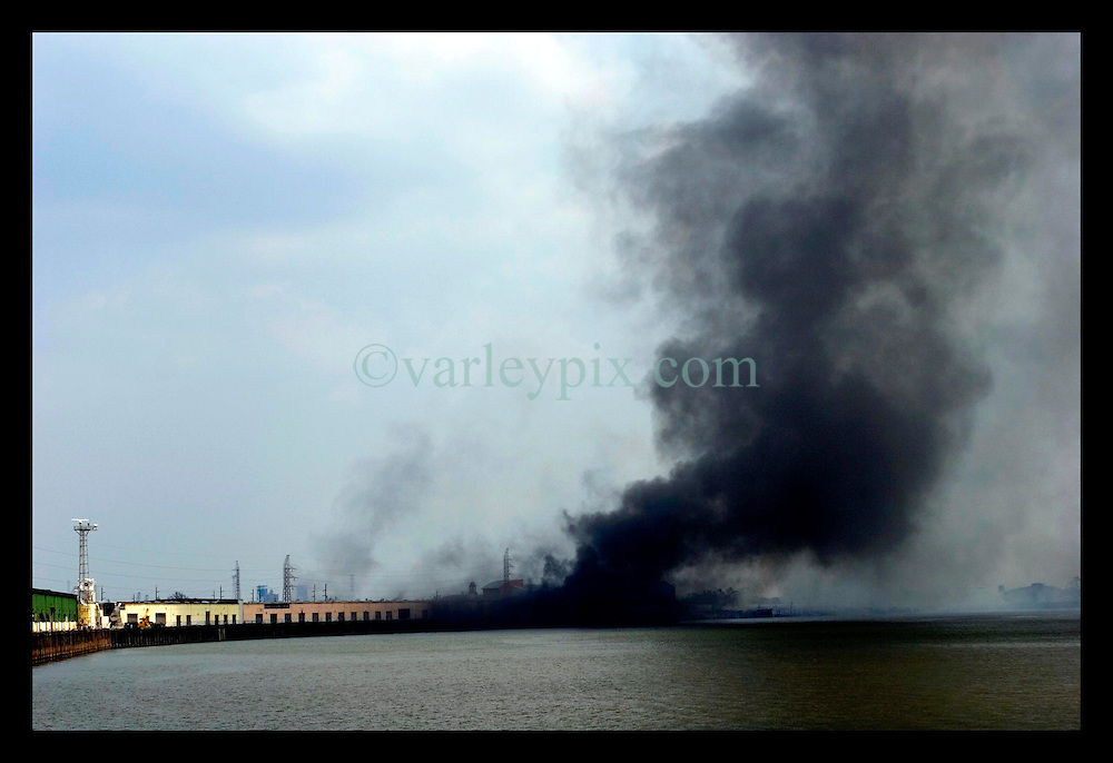 3rd Sept, 2005. Hurricane Katrina aftermath. New Orleans. Mississippi burning. A fire rages out of control along the banks of the Mississippi in New Orleans.