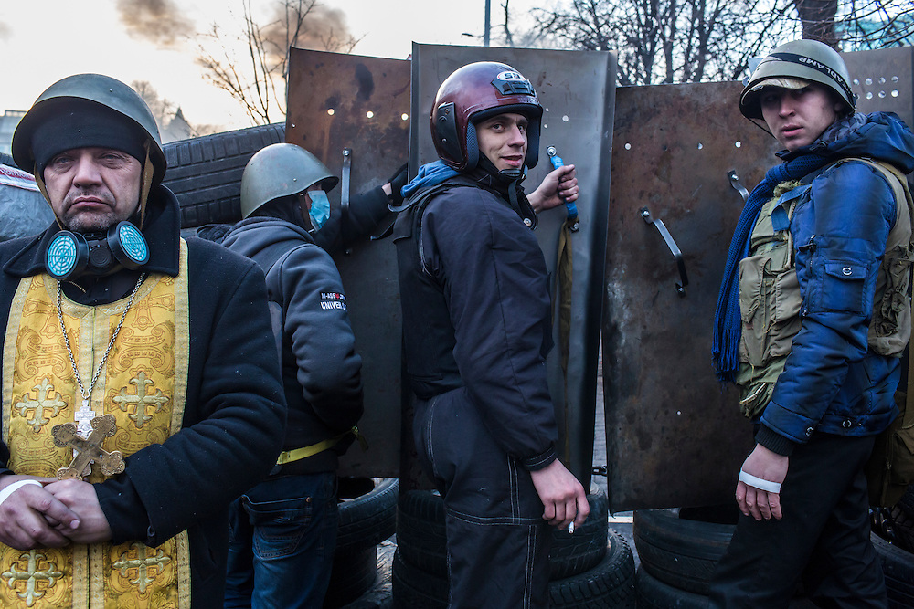 KIEV, UKRAINE - FEBRUARY 21: Anti-government protesters guard barricades near Independence Square on February 21, 2014 in Kiev, Ukraine. After a week that saw new levels of violence, with dozens killed, opposition and government representatives reached an agreement intended to resolve the crisis. (Photo by Brendan Hoffman/Getty Images) *** Local Caption ***