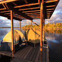 Sunrise greets boat campers who have spent the night in their tents on a chickee platform on the Wilderness Waterway in Everglades National Park, Florida.