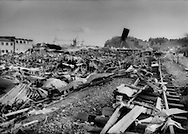 An elevated train line held back the Tohoku tsunami creating a debris field where the town of Kesennuma once stood, after one of the strongest earthquakes in recorded history Miyagi, Prefecture, Japan.  The tsunami had a height of 25m high (82 ft.).