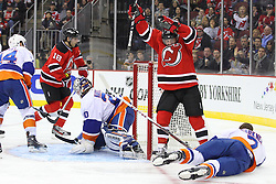 Jan 31, 2013; Newark, NJ, USA; New Jersey Devils right wing Stephen Gionta (11) and New Jersey Devils right wing Steve Bernier (18) celebrate Bernier's goal on New York Islanders goalie Evgeni Nabokov (20) during the second period at the Prudential Center.
