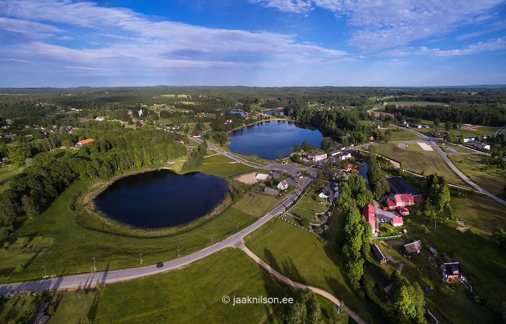 Lake Kaussjärv and Suurjärv in Rõuge, Estonia. Aerial view, winding roads, buildings. Rural landscape, countryside.