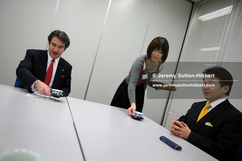 Heizo Takenaka (yellow tie), economist and former Minister in the Koizumi government of Japan, in conversation with American Chamber of Commerce President Charles Lake (red tie), after being nominated ACC Man of the Year 2007, in his Global Security Research Institute offices, Keio University, Tokyo, Japan, Tuesday, Nov. 20, 2007.