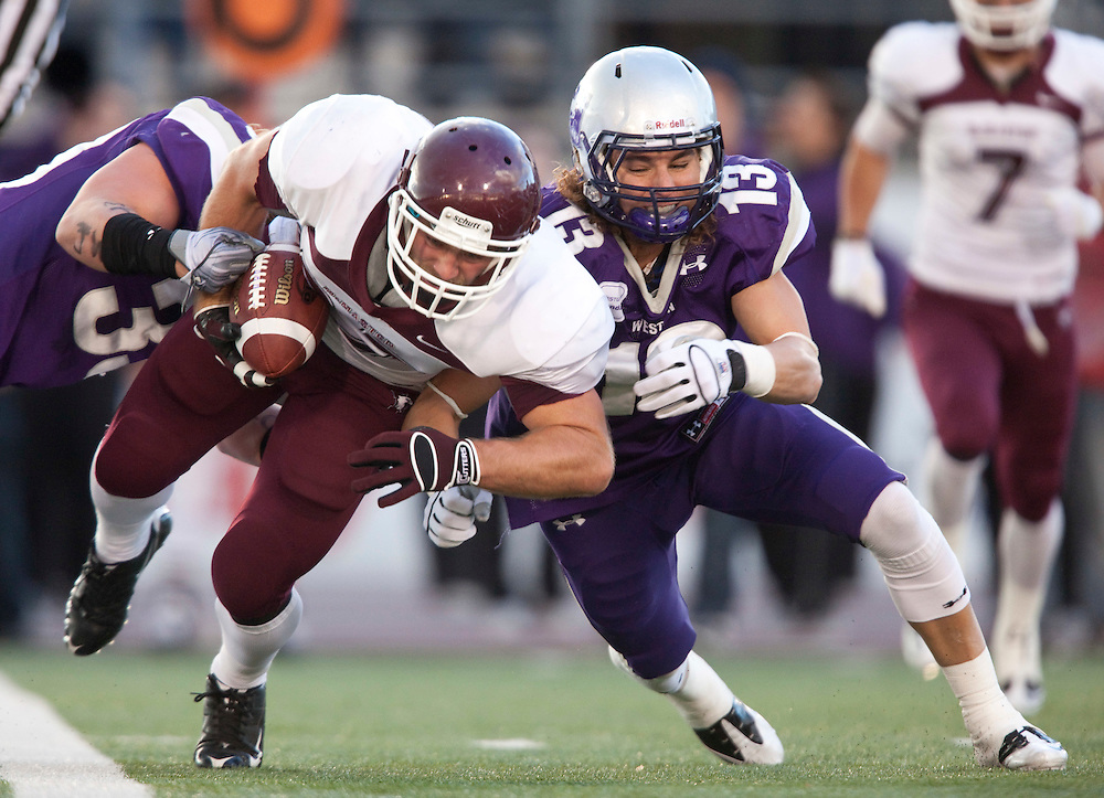 McMaster's Jordan Kozina is tackled by Western's Jason Kosec as the Marauders and Mustangs met for the OUA semi-Final at TD Waterhouse Stadium in London, Ontario, November 6, 2010.<br /> <br /> The Canadian Press/GEOFF ROBINS