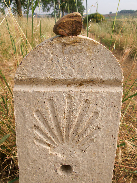 Along the Way of Saint James were many such stone markers. Often they gave distances to Santiago de Compostela. It was common for walkers to pick up a stone en route and lay it on the top of the marker.