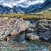 "These are one of many small waterfalls on the isle of Skye. This one part of a larger network of ""Fairy Pools"" in Glenbrittle. This photo is a bit stylized... similar in toning to what a local artist's watercolor of a similar setting looked like."