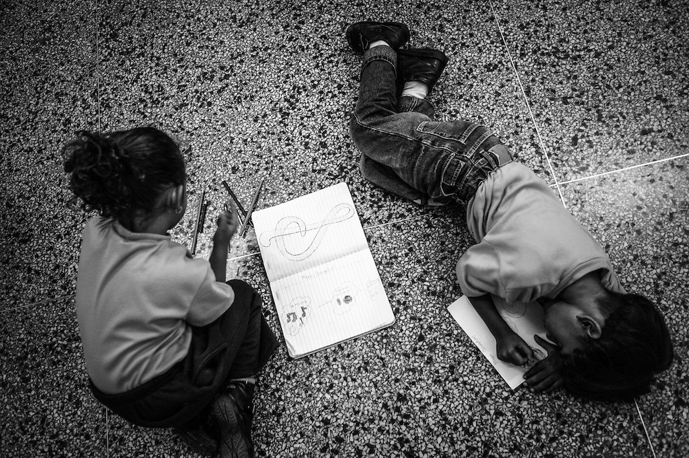 4-year olds involved in the El Sistema program draw and color musical symbols to familiarize them with music in an after school program designed to prepare them to start playing music when they turn 5-years old.