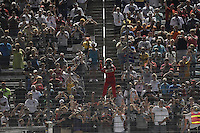 Helio Castroneves climbs the fence, Indy Car Series