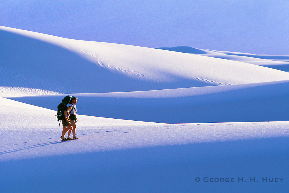 350213-1006 ~ Copyright:  George H. H. Huey ~ Backpackers in Heart of Sands area. White Sands National Monument, New Mexico.