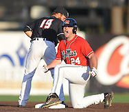 Mississippi's Sikes Orvis (24) hits a double as Louisiana-Lafayette's jace Conrad (19) fields the ball in an NCAA Super Regional game in Lafayette, La. on Saturday, June 7, 2014.