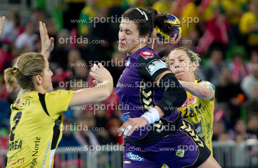 San Martin Barno of Itxako vs Andrea Lekic of Krim during handball match between RK Krim Mercator (SLO) and Itxako Reyno de Navarra (ESP) in Main Round of Women's Champions league, on February  4, 2011 at SRC Stozice, Ljubljana, Slovenia. (Photo By Vid Ponikvar / Sportida.com)