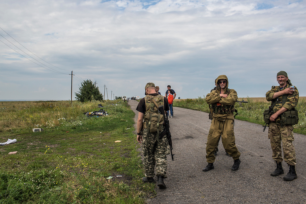 GRABOVO, UKRAINE - JULY 19: Pro-Russia rebels guard the site of the crash of Malaysia Airlines flight MH17 on July 19, 2014 in Grabovo, Ukraine. Malaysia Airlines flight MH17 was travelling from Amsterdam to Kuala Lumpur when it crashed killing all 298 on board including 80 children. The aircraft was allegedly shot down by a missile and investigations continue over the perpetrators of the attack. (Photo by Brendan Hoffman/Getty Images) *** Local Caption ***
