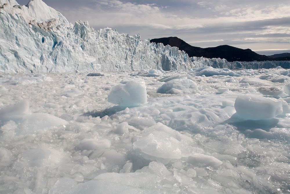 Greenland, Disko Bay, Icebergs floating near active face of Kangilerngata Sermia Glacier on summer morning