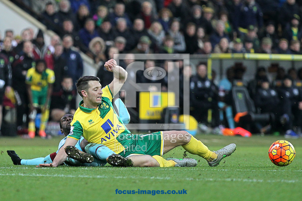 Wes Hoolahan of Norwich is fouled by Pedro Obiang of West Ham during the Barclays Premier League match at Carrow Road, Norwich<br /> Picture by Paul Chesterton/Focus Images Ltd +44 7904 640267<br /> 13/02/2016