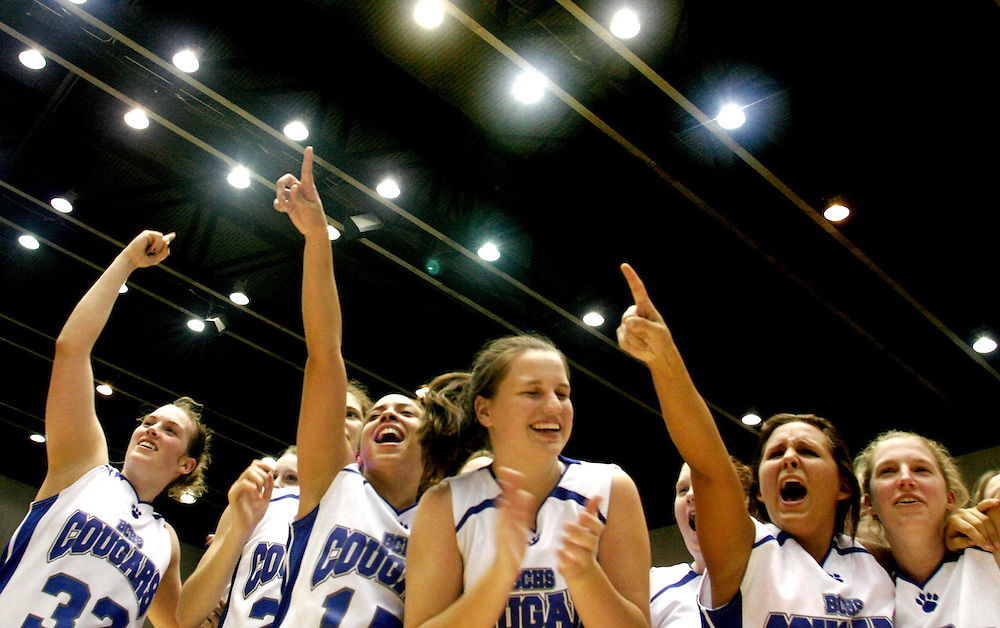 2/22/08 -- LAKELAND -- The Barron Collier girls basketball team celebrates their win over Winter Haven for the Girls Class 5A State Championship at the Lakeland Center on Feb. 22, 2008. Barron Collier won, 33-30. Photo by KELVIN MA / Special to the Naples Daily News