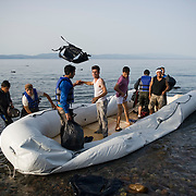 Afghan refugees discard their life jackets after they landed on the beach near Skala Sykaminias in Lesbos island, Greece. Everyday hundreds of refugees, mainly from Syria and Afghanistan, are crossing in small overcrowded inflatable boats the 6 mile channel from the Turkish coast to the island of Lesbos in Greece. Many spend their life savings, over $1000, to buy a space on those boats.