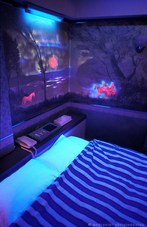 HOTEL KERUN-SHIBUYA. Flourescent paintings lit with black light create a dream-like atmosphere.
