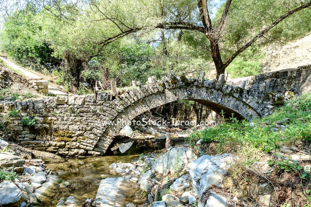 A traditional stone bridge Zagori, Pindus mountains, Epirus, Greece.