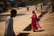 A woman walking on a street in Timbuktu, Mali.