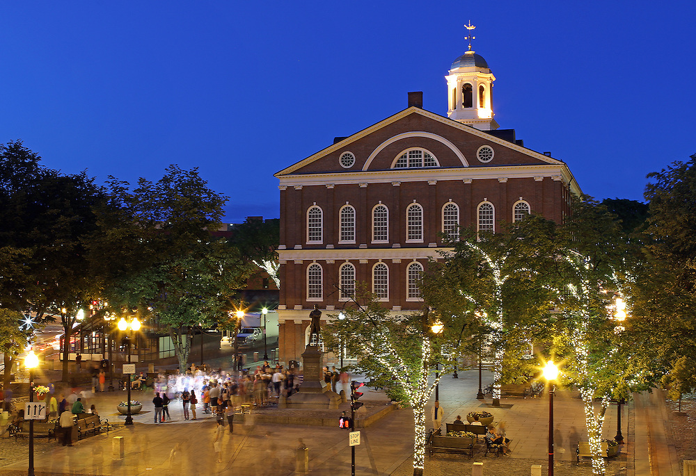 Boston Faneuil Hall marketplace is popular with locals and tourists alike. There are outdoor artists, food stalls, restaurants and shopping areas around Faneuil Hall and Quincy Market. After sunset twilight paints the sky in beautiful blue hues while the city lights around Faneuil Hall and Quincy Market become alive.<br />