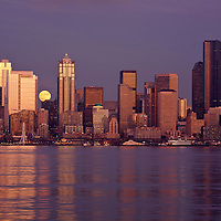 WA10052-00...WASHINGTON - Moon rise over downtown Seattle and Elliott Bay from West Seattle.
