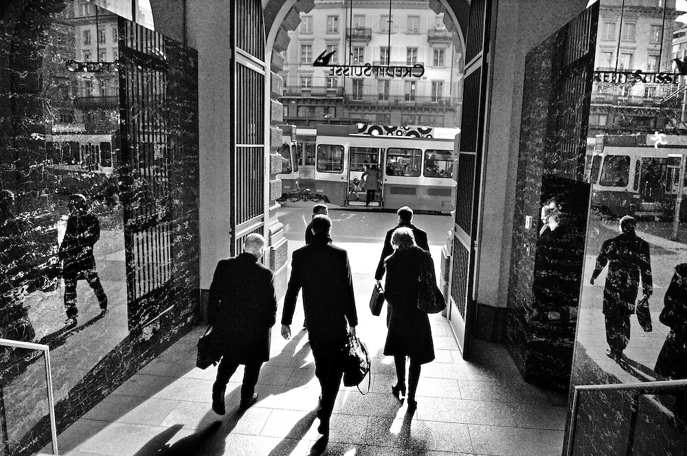 Group of businessmen and women leaving the portal to the head quarters of Credit Suisse, which like its larger rival UBS, stands on Paradeplatz in the heart of Zurich.