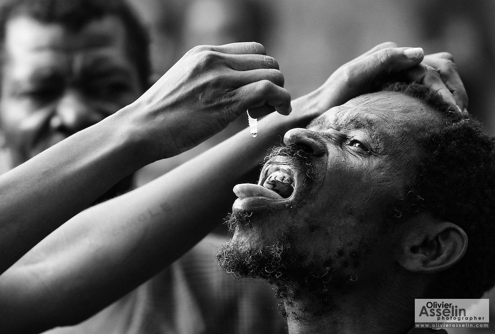 A man gets vaccinated against polio during the second round of vaccination in Djambala Village, Republic of Congo on Wednesday December 8, 2010.