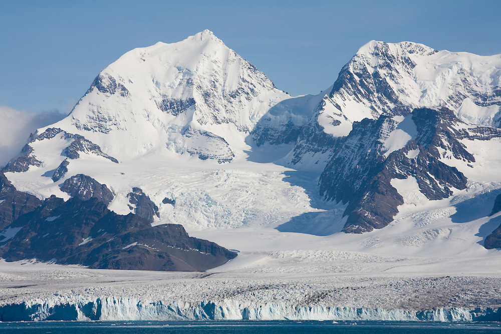 Antarctica, South Georgia Island (UK), Afternoon sun lights Nordenskjold Glacier along Cumberland East Bay in late summer