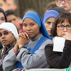 Lisa Johnston | lisajohnston@archstl.org  | Twitter: @aeternusphoto  Servants of the Lord and the Virgin of Matará listened to Pope Francis during his homily.  The Pope closed the 2015 World Meeting of Families with an outdoor Mass celebrated on the Benjamin Franklin Parkway.