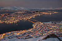 Tromsø is a city and municipality in Troms county, Norway. It is the ninth-largest urban area in Norway by population, and the seventh largest city in Norway by population. It is the largest city and the largest urban area in Northern Norway, and the second largest city and urban area north of the Arctic Circle. Most of Tromsø, including the city centre, is located on the small island of Tromsøya in the county of Troms, 350 kilometres (217 mi) north of the Arctic Circle. Substantial parts of the urban area are also situated on the mainland to the east, and on parts of Kvaløya— a large island to the west. Tromsøya is connected to the mainland by the Tromsø Bridge and the Tromsøysund Tunnel, and to the island of Kvaløya by the Sandnessund Bridge.
