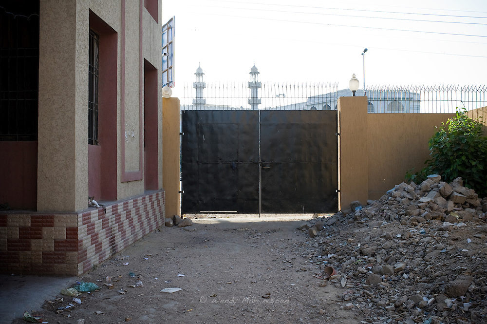 The backside of the gate of the Women's police station, closed off most of the time. <br />