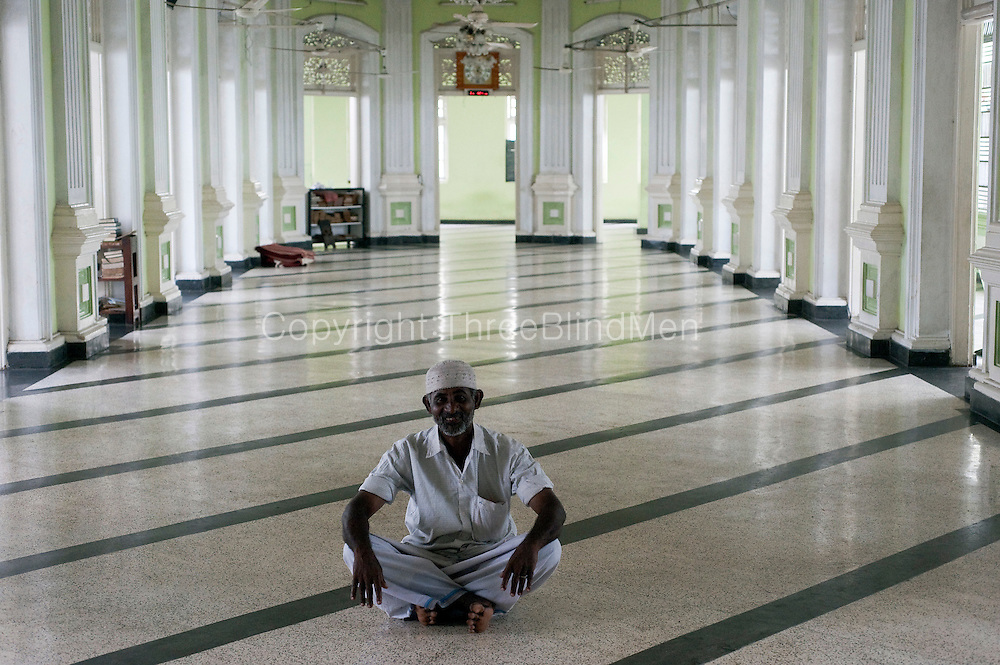 Man at a Mosque in new Moor Street, Colombo.