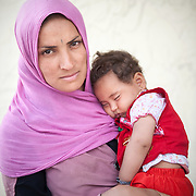 Shefqe 24 years old holding her 7 months old girl Hamid from Chardere district of Afghanistan in Moria camp, Lesvos, Greece