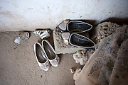Dusty shoes outside patient Shahnoza's home.