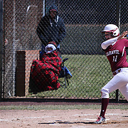 Caravel Academy Infielder Katrina Conner (11) hits two out double in the bottom of the fourth inning of a varsity scheduled game between Caravel Academy and The Delmar Wildcats Saturday, April 4, 2015, at Caravel Athletic Field in Bear Delaware.