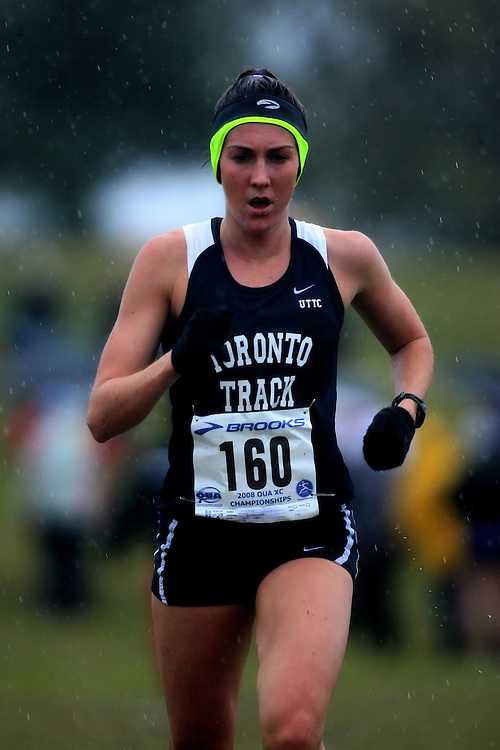 (Kingston, ON---25 October 2008) Megan Brown of TORONTOuniversity running to finish 1 in the 2008 Ontario University Athletics women's cross country championship.  Photograph copyright Sean Burges/Mundo Sport Images (www.msievents.com).