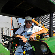 Caption 9<br /> Randell McCloud takes a break before moving grain into silos on September 25, 2013. McCloud Farms grows corn and hay for feed, and corn and soybeans for cash.