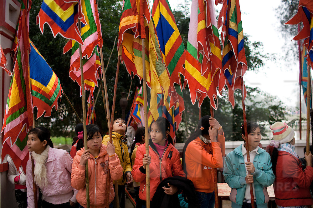 Young vietnamese girls hold flags during a festival in Tien Quang, Vietnam, Asia