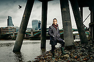 Mudlarker and author of 'London in Fragments', Edward Sandling, photographed on the banks of the river Thames. November 2016. Photo by Greg Funnell.