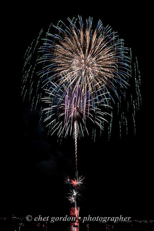 Fireworks explode over Greenwood Lake, NY on Sunday evening, July 5, 2015.  © Chet Gordon • Photographer